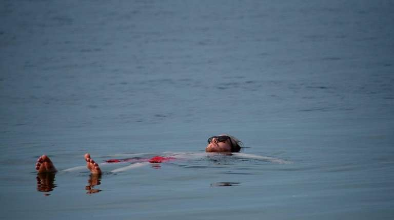 George Talboys, 27, of Oyster Bay, floats in