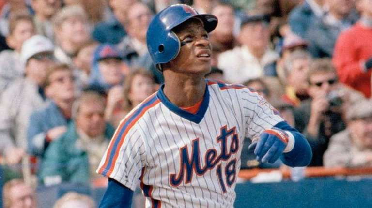 Darryl Strawberry of the Mets watches his three-run