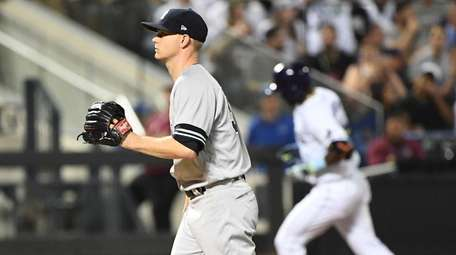 Yankees starter Sonny Gray walks back to the mound