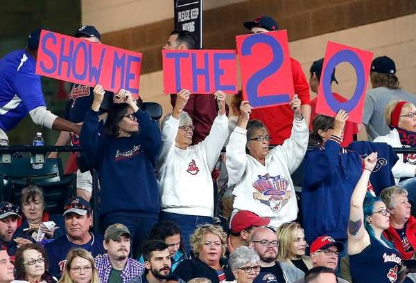 Indians fans cheer for their team to win