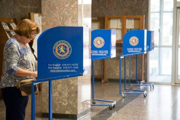 Margaret Cohn, Mineola, cast her ballot in the