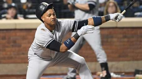 Yankees second baseman Starlin Castro strikes out against