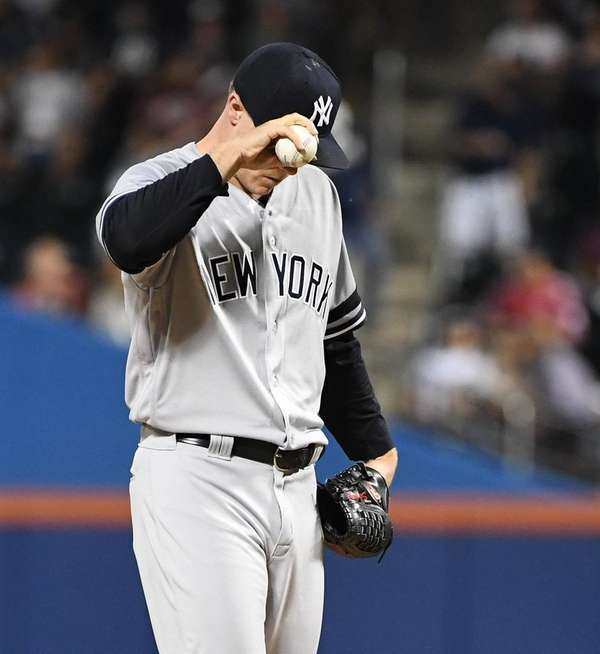 Yankees pitcher Sonny Gray reacts after Rays centerfielder Kevin Kiermaier