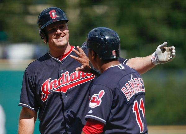 The Indians' Jay Bruce celebrates with Jose Ramirez