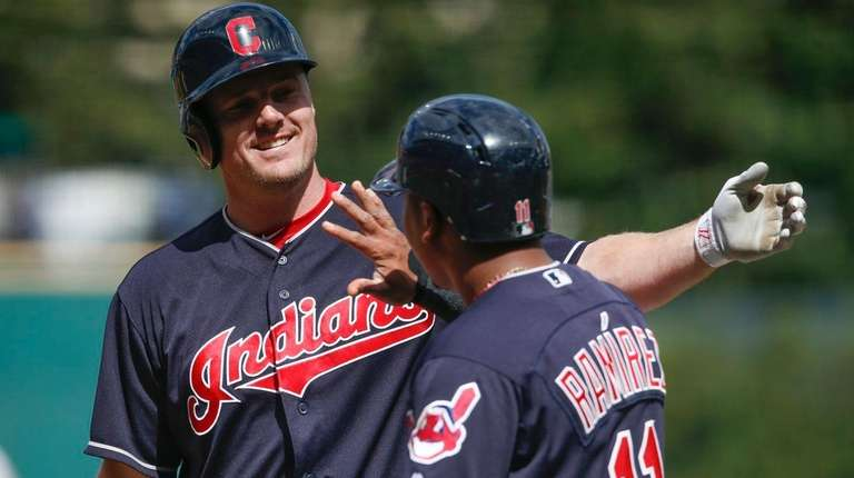 The Indians' Jay Bruce celebrates with Jose Ramirez