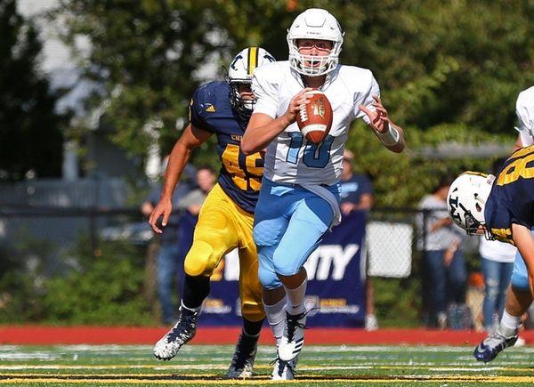 Tommy Heuerof Oceanside runs the ball against Daniel