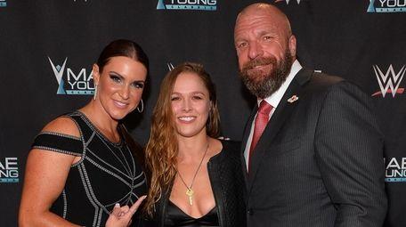 Stephanie McMahon, Ronda Rousey and Paul