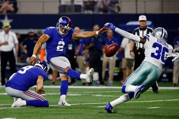 Giants'Aldrick Rosaskicks a field goal during a game