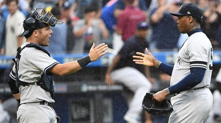 Yankees catcher Austin Romine and relief pitcher Aroldis