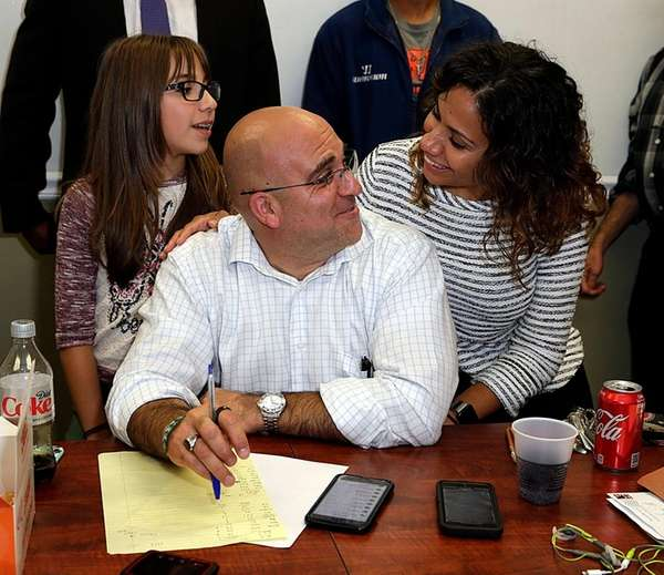 Candidate Larry Zacarese between daughter Lourdes, 11, and