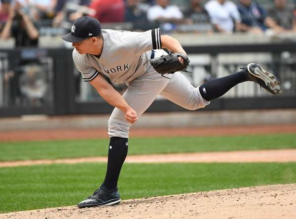 Yankees reliever Chad Green delivers against the  Rays