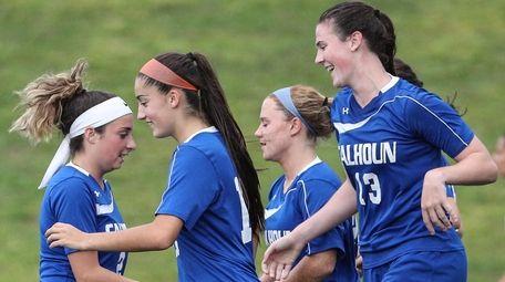 Calhoun teammates celebrate Kathryn Healy's goal during the