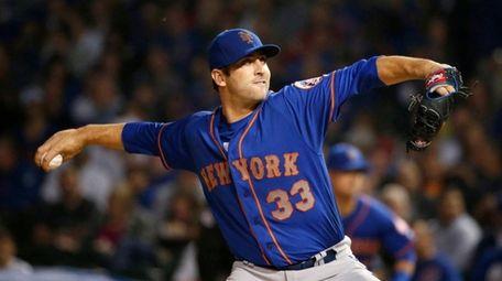 Mets starter Matt Harvey delivers during the first