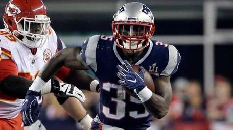 Patriots running back Mike Gillislee runs the ball during a game
