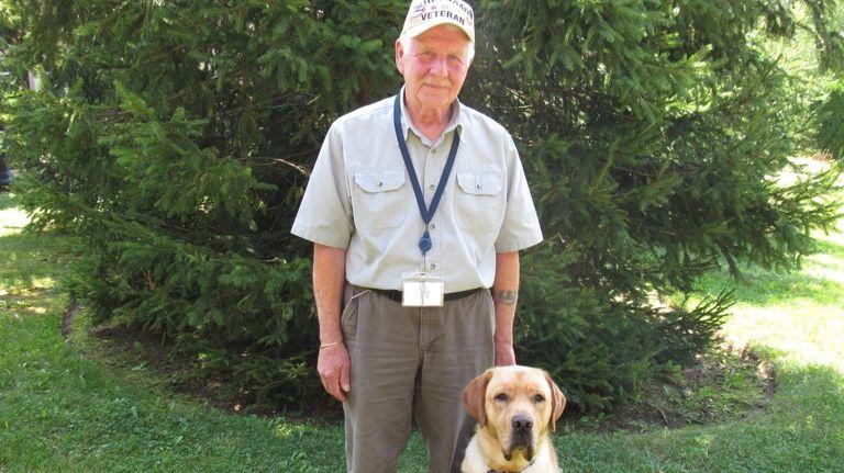 Vietnam veteran Robert Rapone with his service dog,