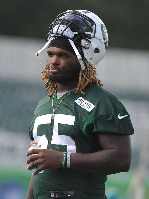 Lorenzo Mauldin heads off the field after Jets