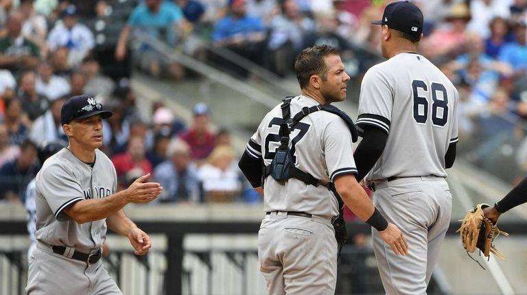 Yankees manager Joe Girardi reaches to take the