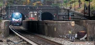 An Amtrak locomotive emerges from the North River