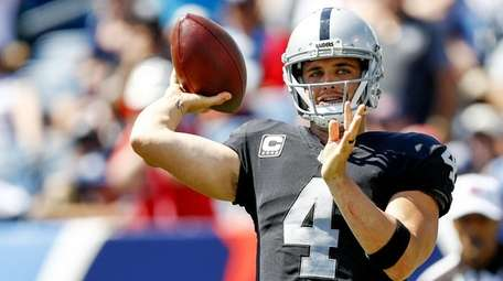 Quarterback Derek Carr of the Raiders passes the ball