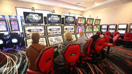Patrons take to the slot machines at Jake's