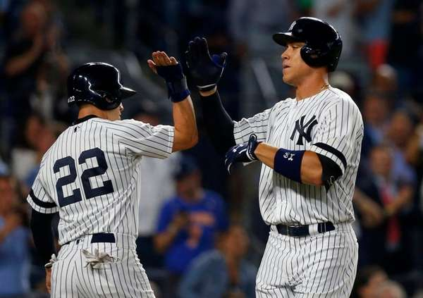 Yankees outfielder Aaron Judge celebrates with Jacoby Ellsbury