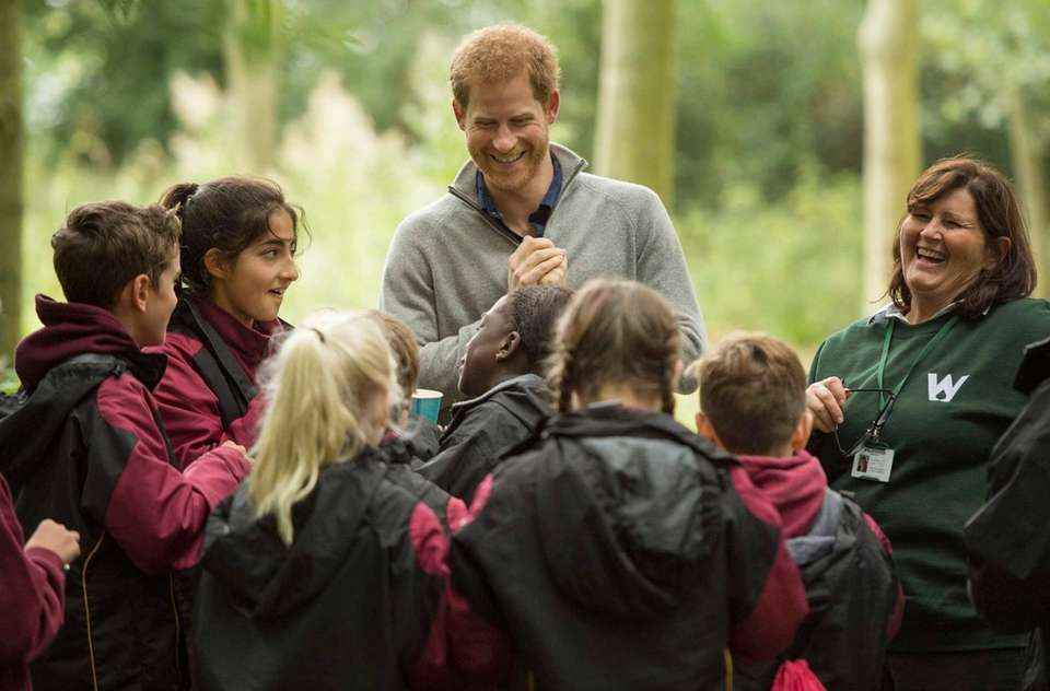 Prince Harry samples nettle tea with students from