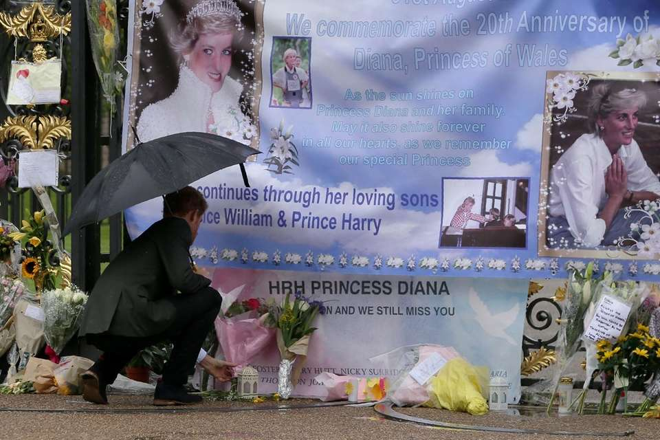 Prince Harry places flowers alongside tributes left by