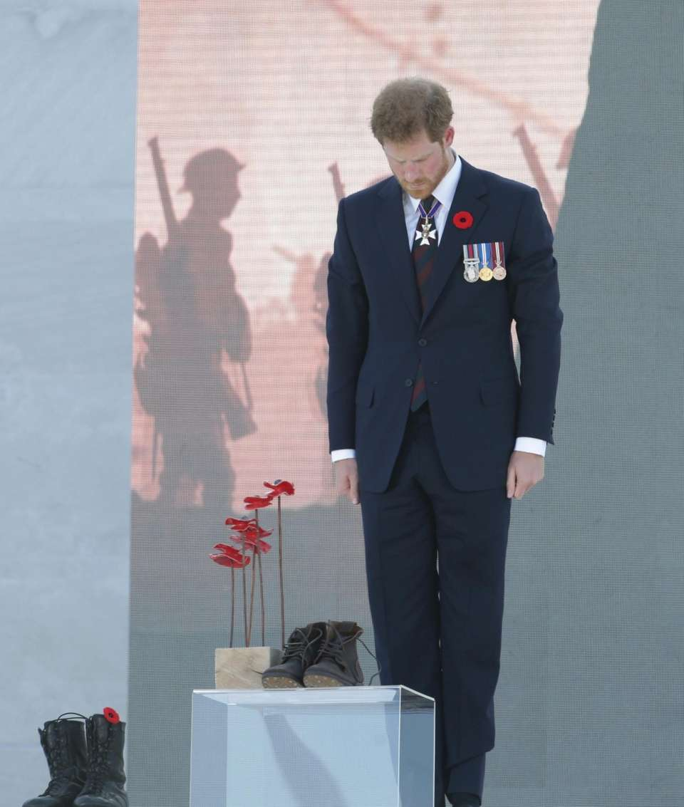 Prince Harry lays boots in remembrance at Vimy