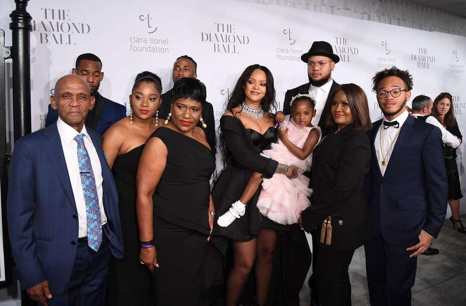 Rihanna and her family attend her third annual