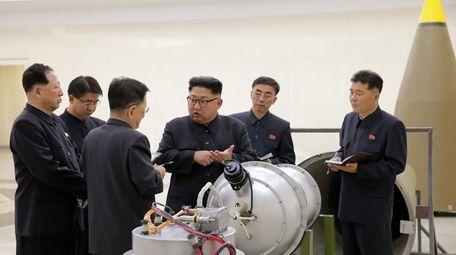 North Korean leader Kim Jong Un, center, at