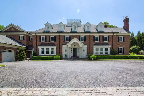 This Georgian-style brick home in Huntington sits next