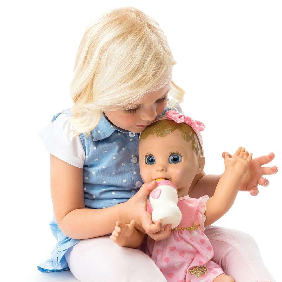 This life-like baby doll comes with interactive accessories,