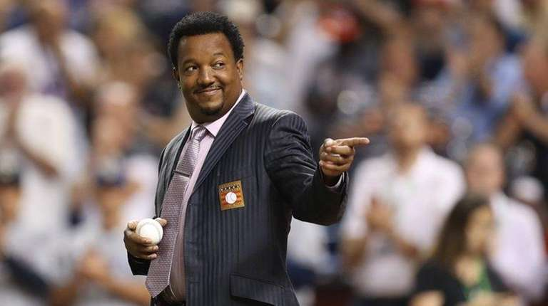 Pedro Martinez throws out the first pitch during