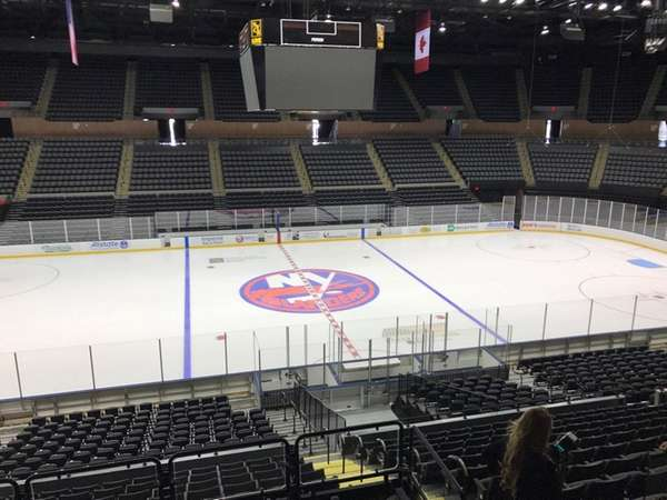 The Islanders logo is seen on the ice