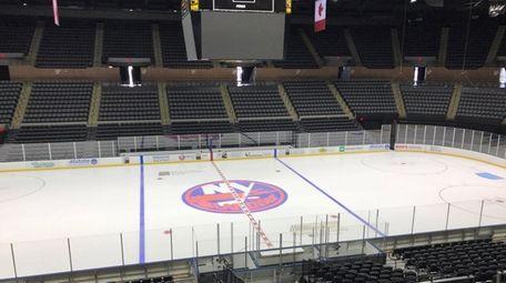 The Islanders logo is seen on the ice