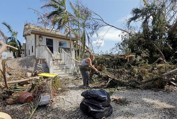 Nancy McCrosson recently cleans up her front yard