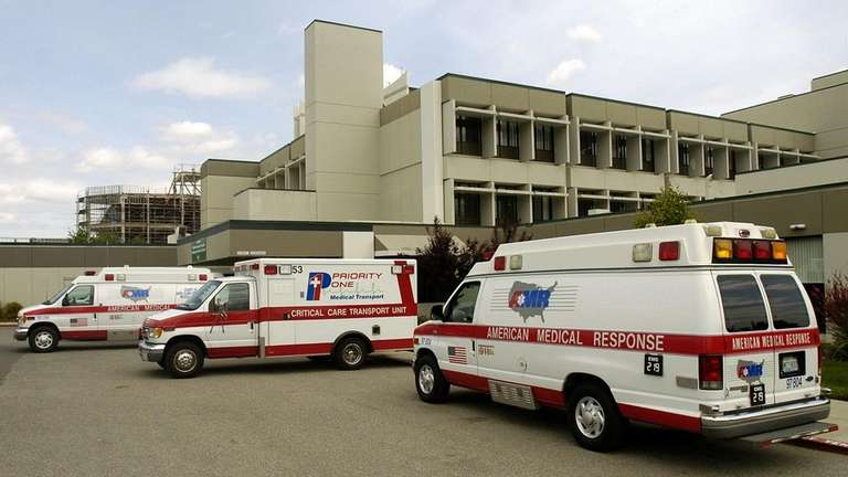 Ambulances are parked outside the emergency room at