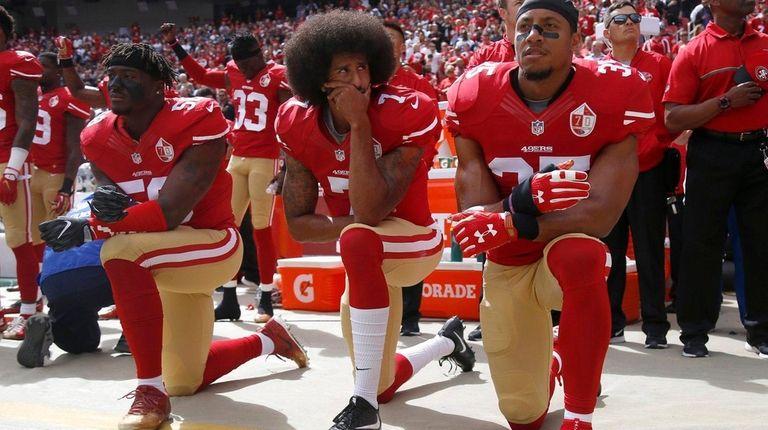 From left, San Francisco 49ers' Eli Harold, Colin