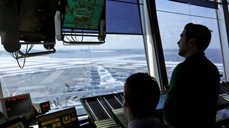 Air traffic controllers in the tower at Kennedy