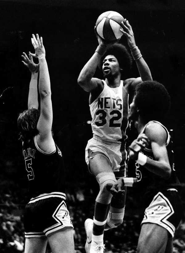 The Nets' Julius Erving drives to the basket