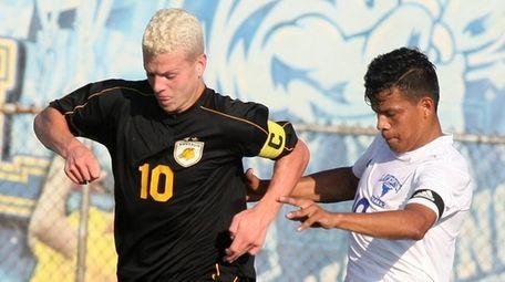 Wantagh's Nick Cerasi battles Lawrence's Wesley Vasquez for
