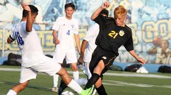 Wantagh's Austin Henglein fights for the ball against
