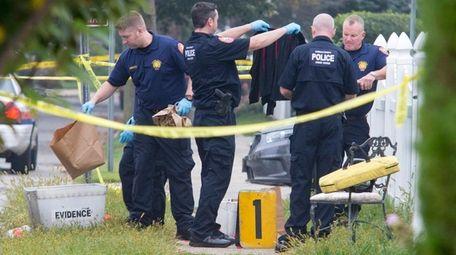 Nassau County police investigate the scene early Saturday,