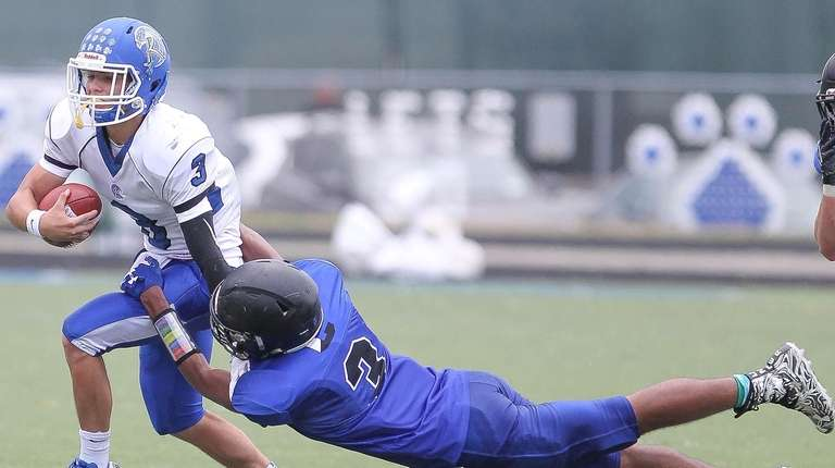 Riverhead's Christian Pace (3) gets taken down by