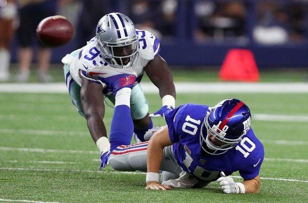 Benson Mayowa of the Cowboys knocks Giants