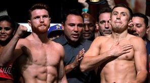 Boxers Canelo Alvarez (R) and Gennady Golovkin pose