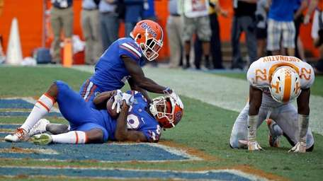 Florida wide receiver Tyrie Cleveland, bottom left, celebrates