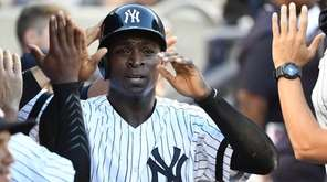 New York Yankees shortstop Didi Gregorius is greeted
