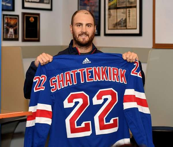 Kevin Shattenkirk of the Rangers poses with his jersey during a