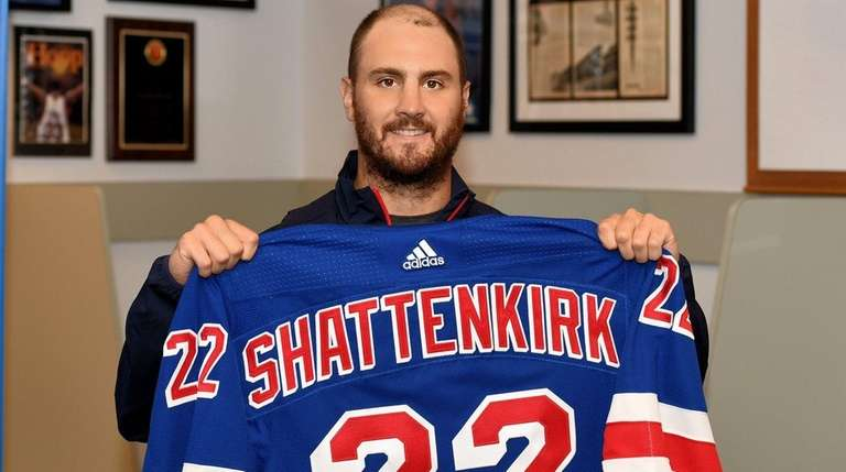 Kevin Shattenkirk of theRangers poseswith his jersey duringa